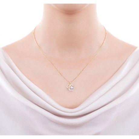 Parure Chiaky. Ciondolo e Orecchini in Oro giallo, Perle Akoya e Diamanti