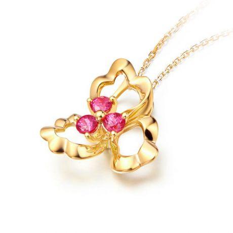 Ciondolo fiore dai tre petali - Oro giallo e rubini