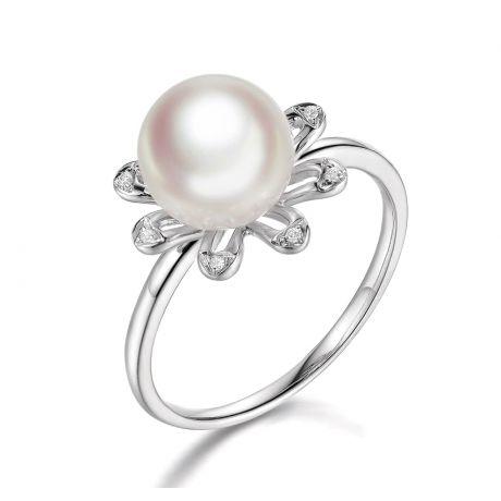 Anello fiore delle nevi. Oro bianco, petali di diamanti
